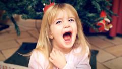 Christmas Eve little girl happy hooray Stock Footage