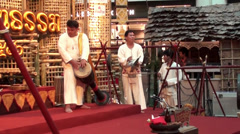 Musicians play traditional instruments at a Northern Thailand cultural show Stock Footage