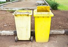 old yellow trash in the park - stock photo