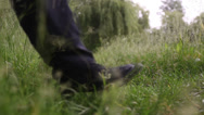 Stock Video Footage of stranger, walking on the grass 3