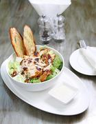 caesar salad with chicken and croutons, cheese - stock photo