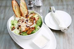 Caesar salad with chicken and croutons, cheese Stock Photos