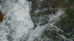 Water Flowing over Rock Stock Footage