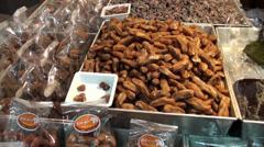 Thai Food 5 - Customers inspect displays of sweetened fruit Stock Footage