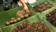 Stock Video Footage of Thai Food 8 - Grubs with dressing at a Northern Thailand cultural show