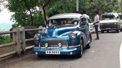 Retro family car Morris Minor on the road in Sri Lanka. Stock Footage