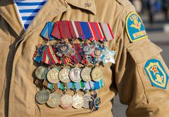 numerous military awards and medals on the uniform of veteran special troops - stock photo