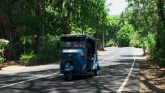 Road traffic with Tuk-Tuk  in Sri Lanka. Stock Footage