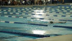 Swimmers at a swim meet Stock Footage