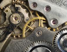 Gold silver precision antique vintage pocket watch bodies parts gears Stock Photos