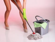 legs and hand mop cleaner girl woman housewife - stock photo