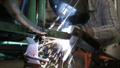 Welder working on vehicle repair sparks HD 1222 Stock Footage