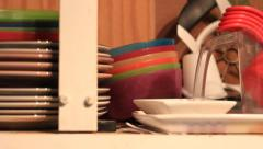 PAN OF MESSY KITCHEN CABINET Stock Footage