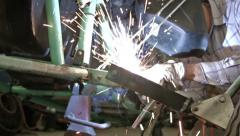 Welding repair vehicle axle shop HD 1221 Stock Footage