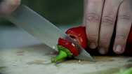 Stock Video Footage of Chopping off paprika top