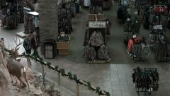 Couple walks in Cabelas sporting goods deer HD Stock Footage