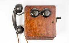 vintage obsolete oak telephone set bakelite handset wallbox ringer - stock photo