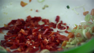 Stock Video Footage of Paprika added to dish with other vegetables