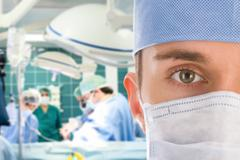 Male surgeon with his team Stock Photos