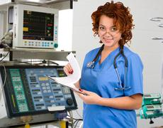 female physician in intensive care unit - stock photo