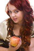 Stock Photo of young woman with apple