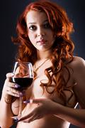 Naked women with wineglass Stock Photos