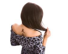 young women hieroglyphic tattoo - stock photo