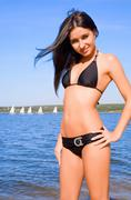 woman in bikini at river coast - stock photo