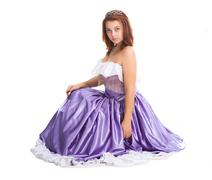 Young attractive woman in lilac-coloured ball dress Stock Photos