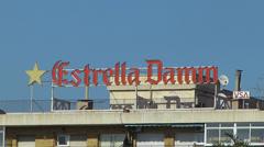Spain Catalonia Barcelona Estrella Dumm beer brand billboard Stock Footage
