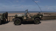 Stock Video Footage of jeep  on Omaha beach .mp4