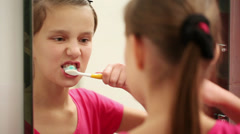 Girl cleans teeth. Stock video hd - stock footage