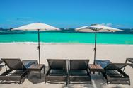 Stock Photo of Beach umbrellas and loungers on perfect white beach