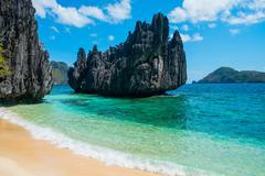 Beautiful beach and mountain islands - stock photo