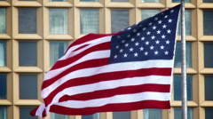 4K American Flag Blowing in front of Office Building 3787 Stock Footage