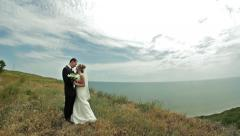 Stock Video Footage of Bride and Groom Standing Near Coast