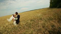 Wedding Couple in a Field Stock Footage