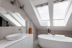 urban apartment - bathroom on the attic - stock photo