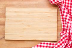cutting board and  red napkin - stock photo