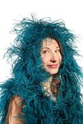beautiful woman with blue feather boa - stock photo
