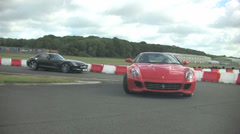 Supercars exit race track Stock Footage