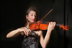 Beautiful violinist Stock Photos