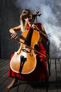 Beautiful cello musician Stock Photos
