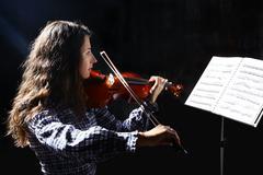 beautiful violinist musician - stock photo