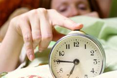 Disturbing a sleeping woman Stock Photos