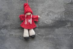 Generic machine made christmas peg dolly ornament on rustic style background Stock Photos