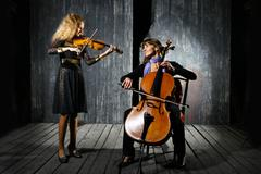 cello and violin musicians - stock photo