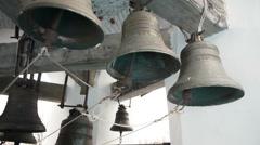 Bells striking by bell ringer in monastery - stock footage