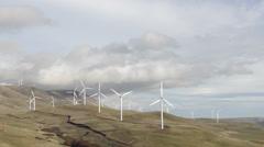 Windmills on Mountainside pan Stock Footage