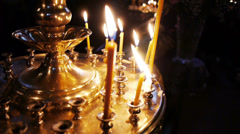 Burning flame of candles in church Stock Footage